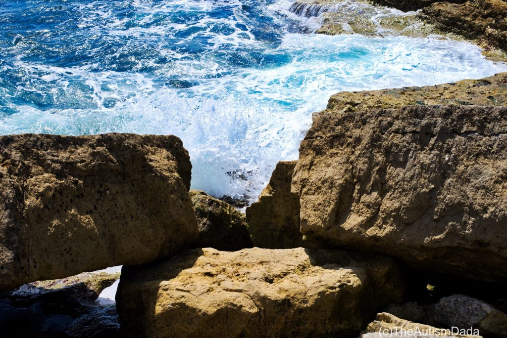 Rocks with breaking waves